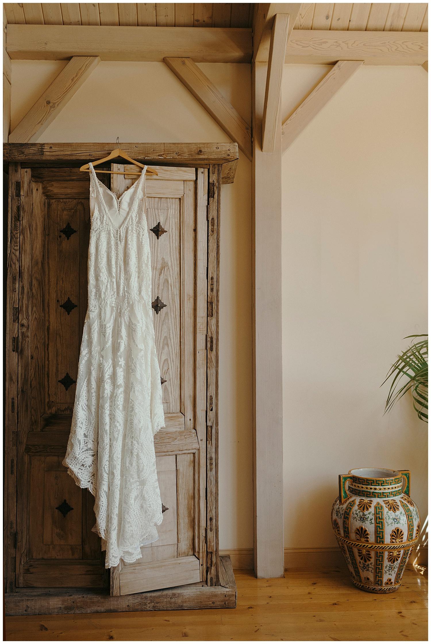 indoors hanging wedding dress at santa barbara wedding