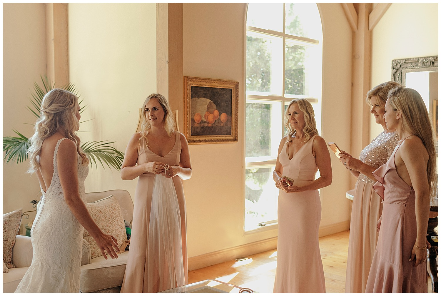 bride first look with bridal party for santa barbara wedding