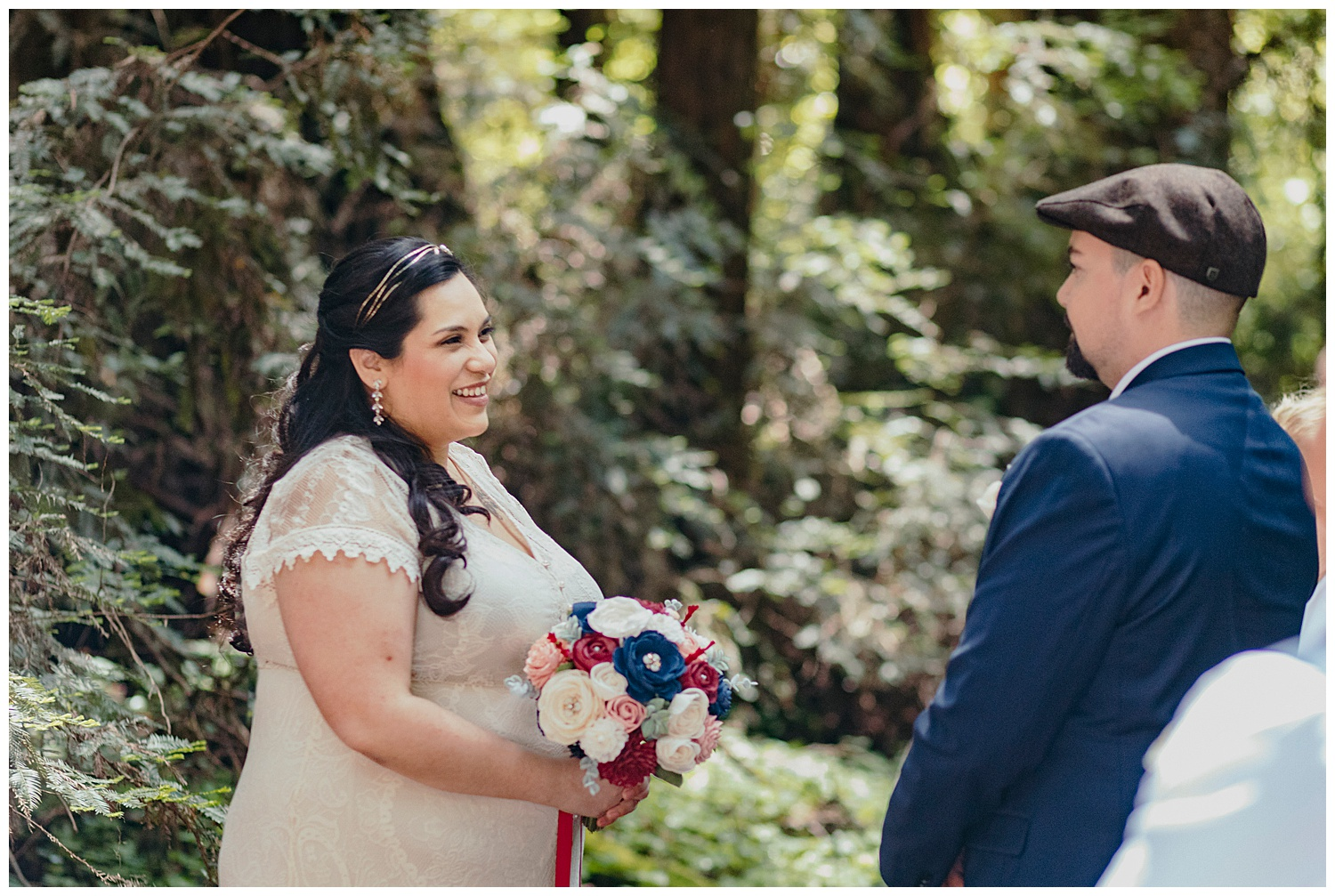 Bride smiles at groom during Henry Cowell redwoods wedding