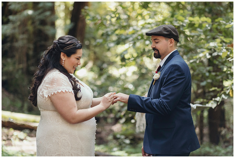 Bride puts ring on groom in Henry Cowell redwoods wedding