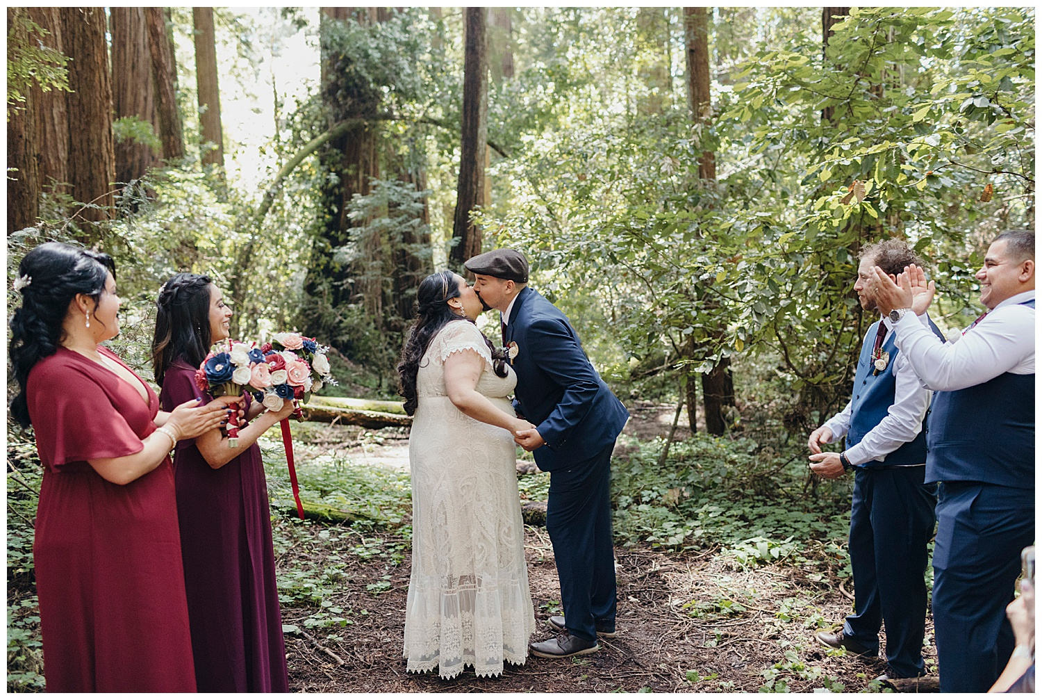 Bride and groom kiss in Henry Cowell redwoods wedding ceremony