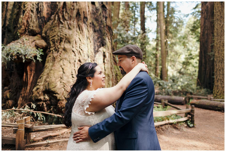 Bride looks sweetly at groom in Henry Cowell redwoods