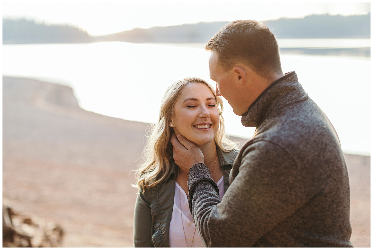 girl smiling in engagement pictures at Jenkinson lake