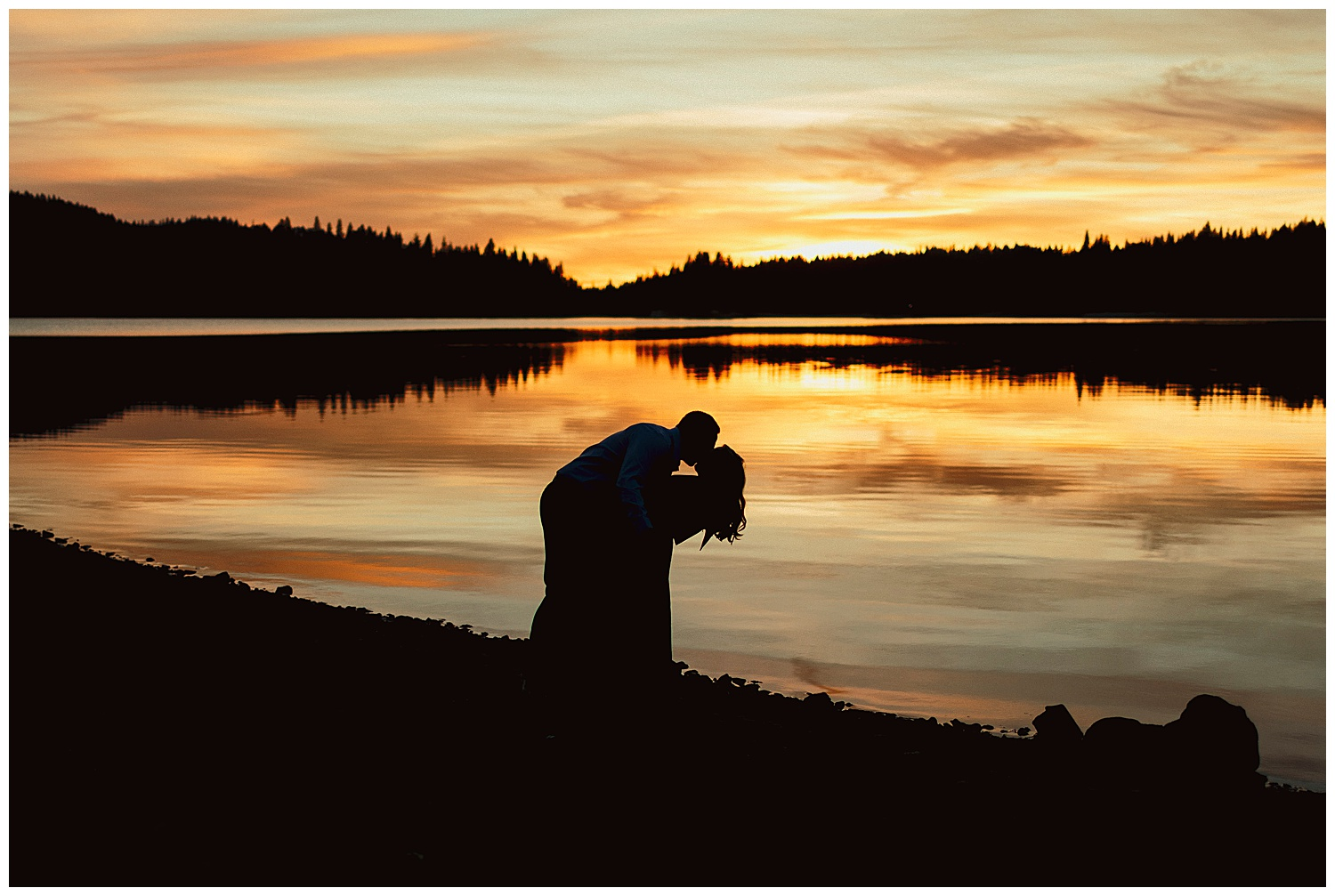 couple silhouette at Jenkinson lake in el dorado national forest