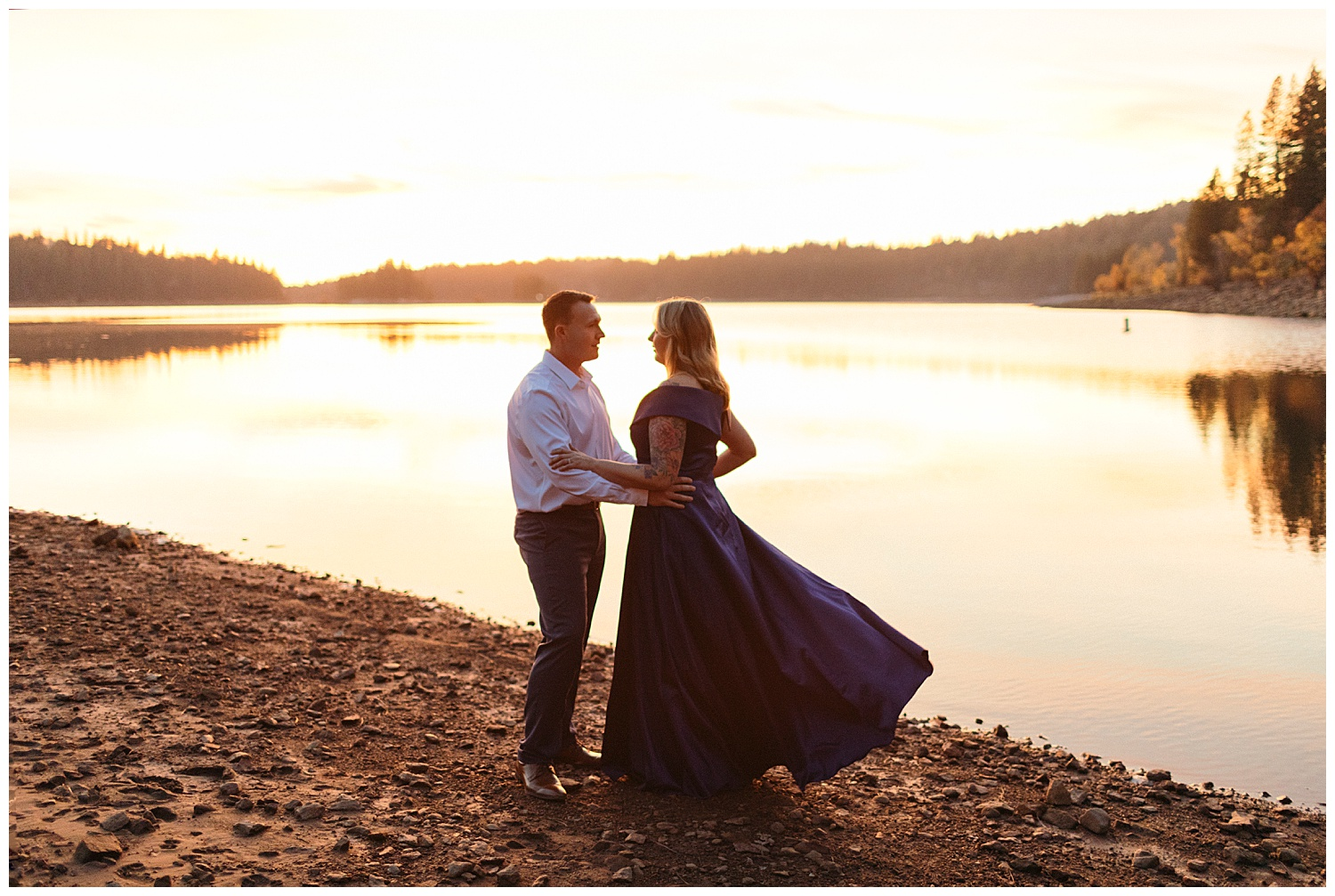 fiery sunset couple pose engagement pictures in el dorado national forest