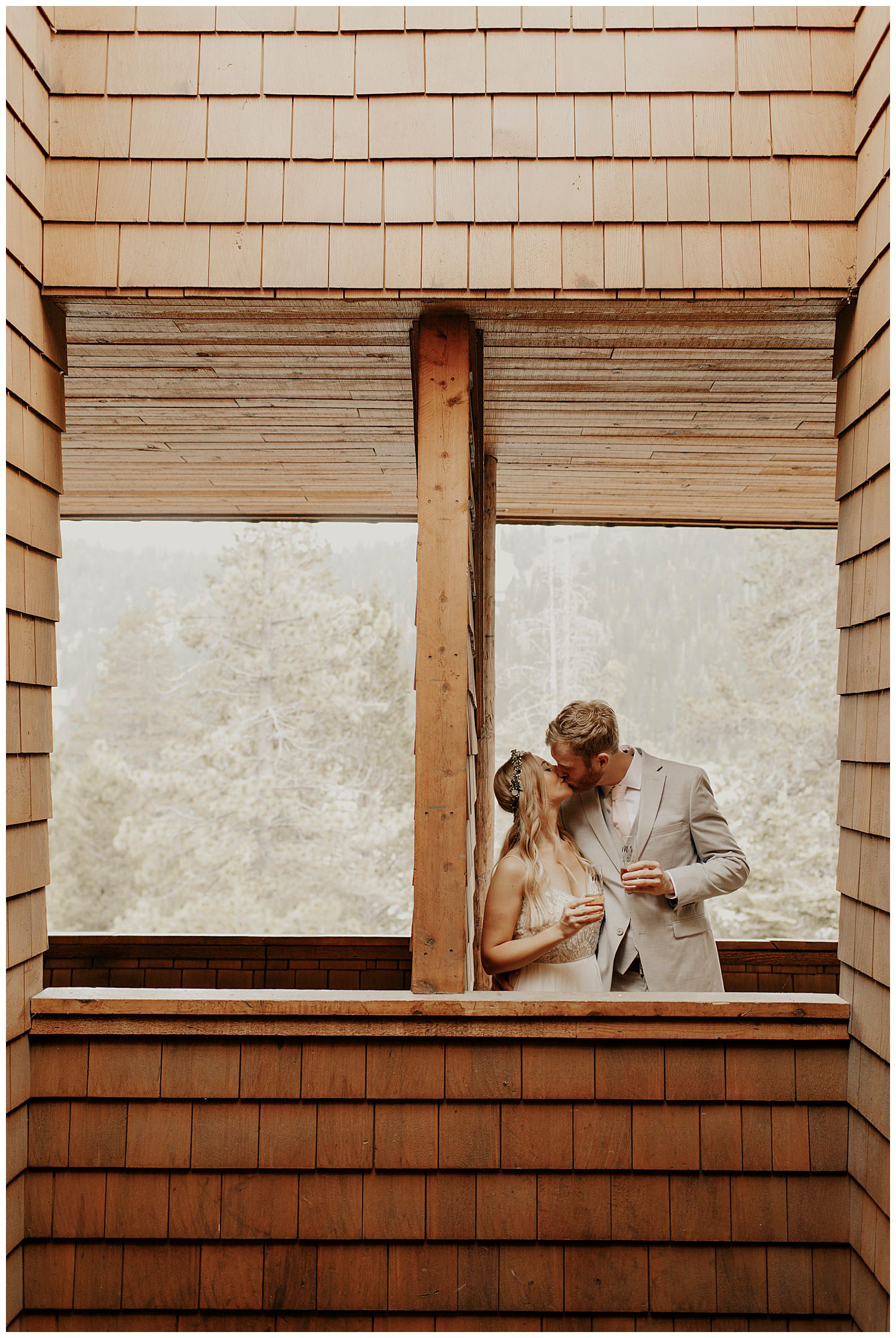 couple kiss in squaw valley on wedding day