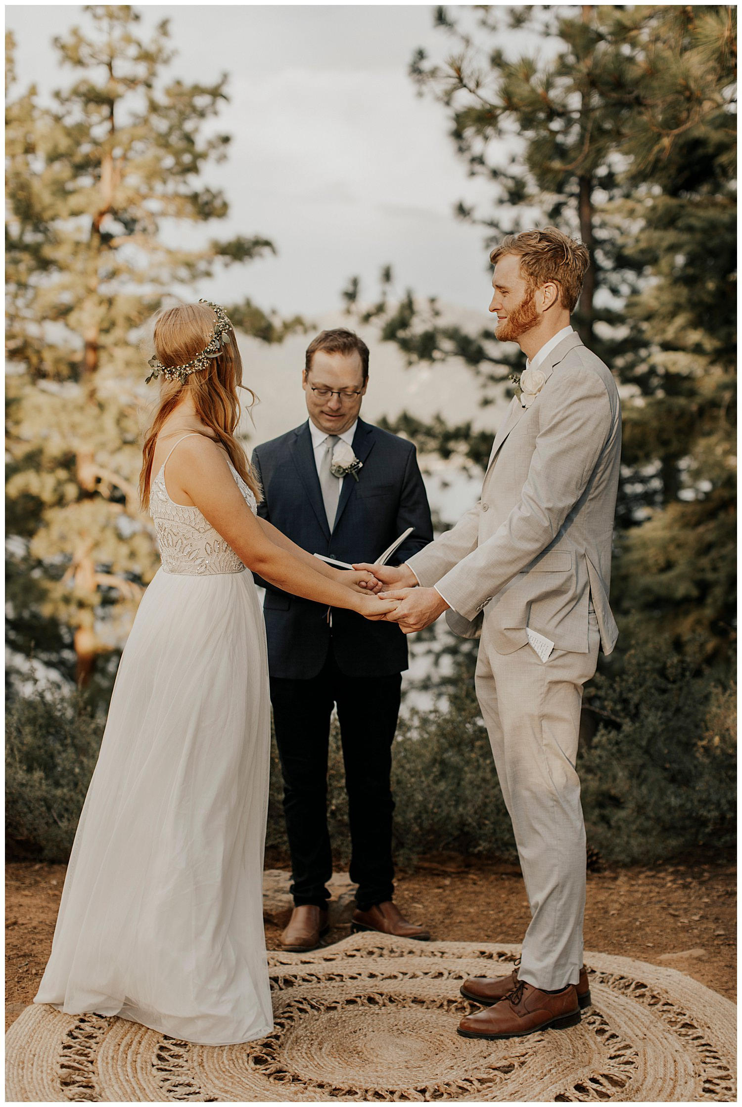 bride and groom take hands in lake tahoe elopement