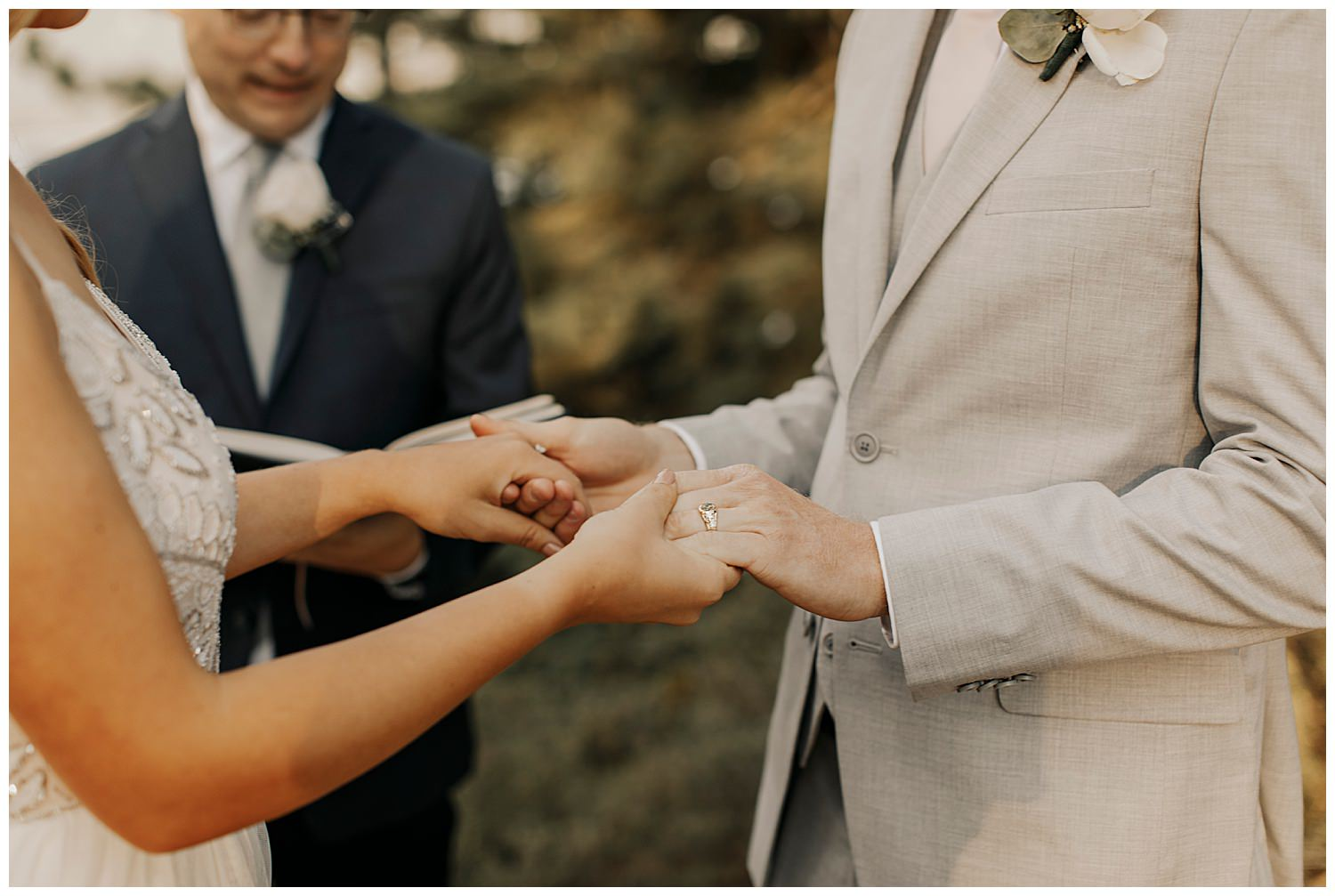 groom wears ring at lake tahoe elopement