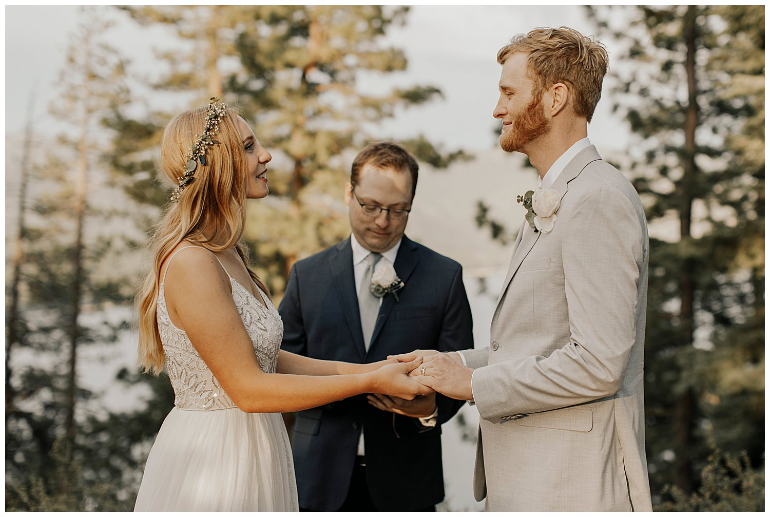 bride and groom smile at each other after exchanging rings at lake tahoe elopement