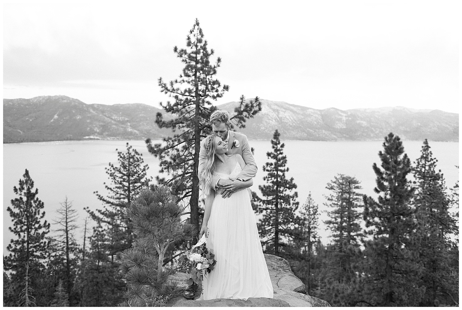 mountains and lake tahoe behind bride and groom after elopement