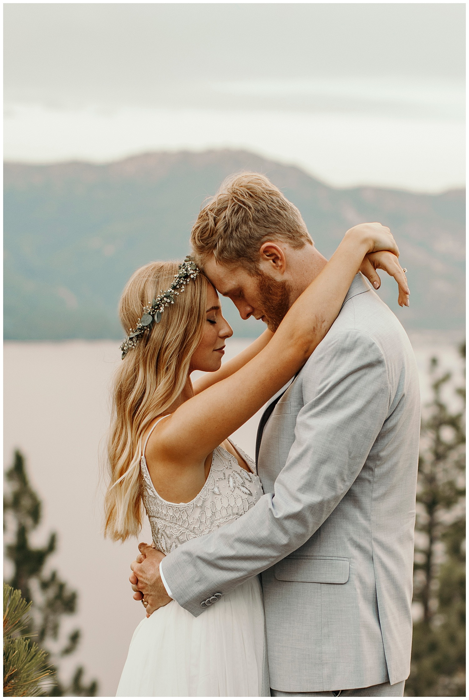 bride and groom share moment in lake tahoe after their elopement