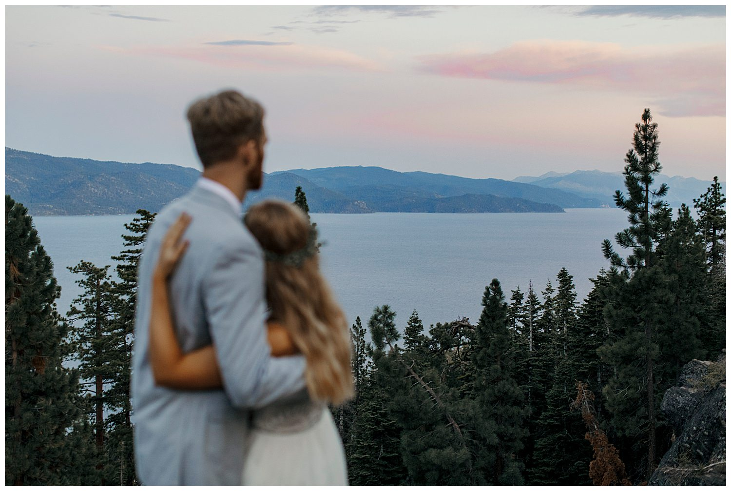 couple watching sunset in lake tahoe after their elopement